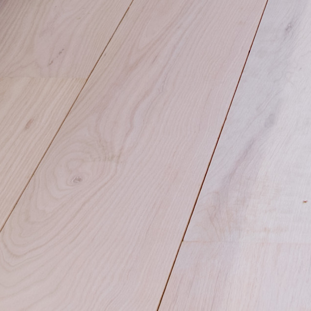 Engineered White Ash flooring. Wide-plank in long lengths. Extra-Long Tongue / Gappy for exaggerated floorboard definition or a Ship Deck Style. definition.