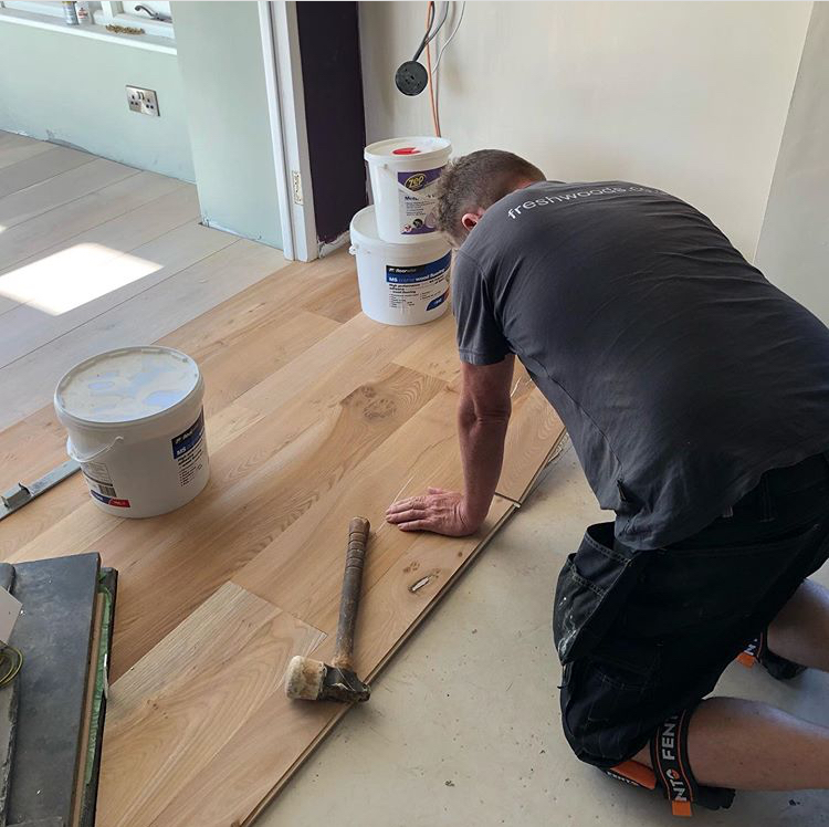 how to install engineered wood flooring diy guide glue down